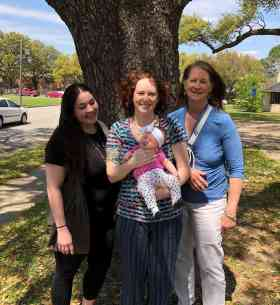 Midwife Lynneece Rooney, CNM, Doula Michelle Johnson, CLD, and client with sweet baby at their 6 week visit