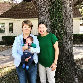 Midwife Connie Blokkum, CNM and client with baby at their six week postpartum visit.