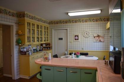 Enjoy a glass of crisp lemon water in our retro kitchen.
